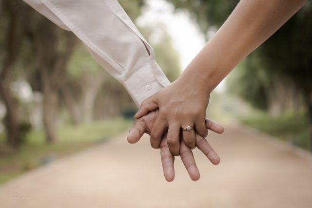 Holding Hands of Boy and Girl